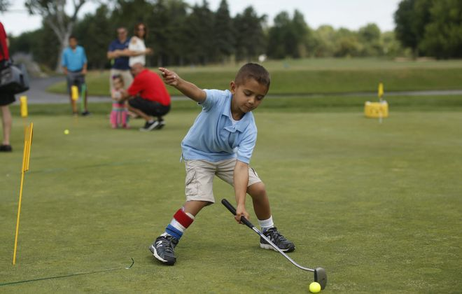 """Matthew Schroeder, 5, of North Tonawanda, putts during the Tops Charity Golf Outing at Transit Valley Country Club on Sunday to benefit the new Oishei Children's Hospital.  Schroeder had surgery to fix a brain bleed in 2013, and is this year's """"Miracle Child."""""""