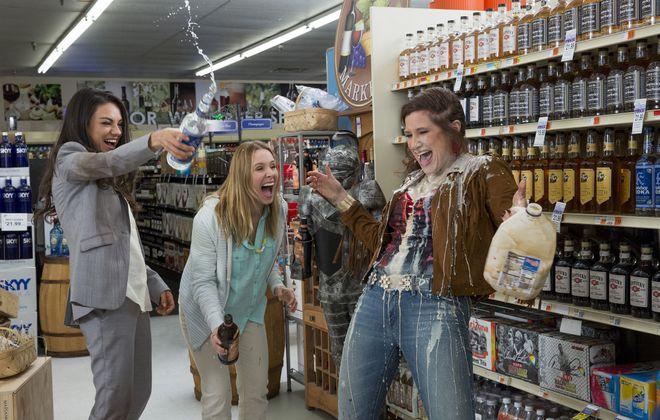 """Exhausted by helicopter parents and other stresses, Mila Kunis, left, Kristin Bell andKathryn Hahn let loose in """"Bad Moms"""" and take aim at the mean girls of the PTA. MUST CREDIT: Michele K. Short, STX Productions."""