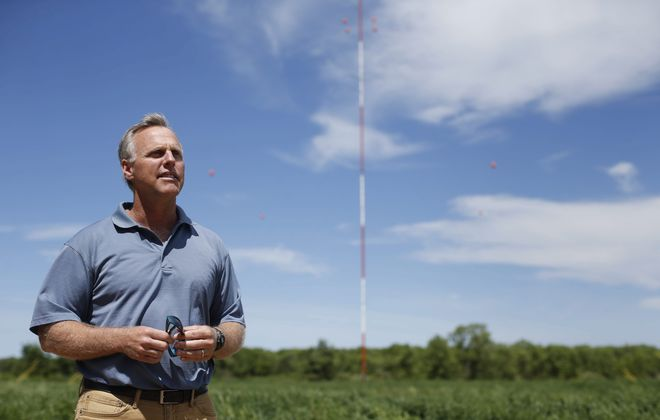 Apex Clean Energy Director of Environmental Permitting Dave Phillips at a site where the company is collecting weather data on a Lyndonville farm where they plan to build a large-scale wind power production network consisting of around 70 wind turbines in Somerset and Yates called Lighthouse Wind, Wednesday, June 1, 2016.  (Derek Gee/Buffalo News)