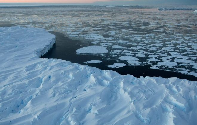 Melting polar ice is contributing to an unprecedented rise in sea water levels. (Torsten Blackwood - Pool/Getty Images)