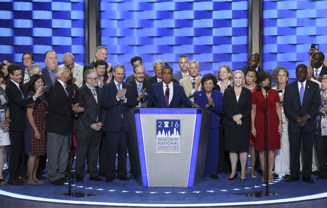 Adriano Espaillat, a New York state senator, and members of the New York delegation, including Erie County Executive Mark C. Poloncarz, left at podium, Lt. Gov. Kathy Hochul and Mayor Byron Brown, right of podium. (Jim Wilson/The New York Times)