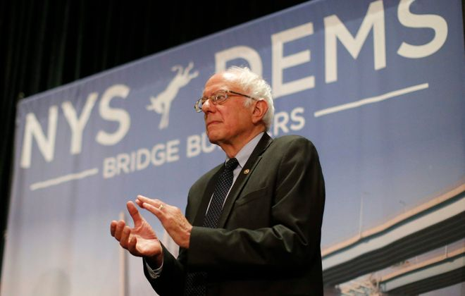 Sen. Bernie Sanders takes the stage to address DNC delegates from New York during the New York delegation breakfast at the Loews Hotel in Philadelphia, Tuesday.  (Derek Gee/Buffalo News)