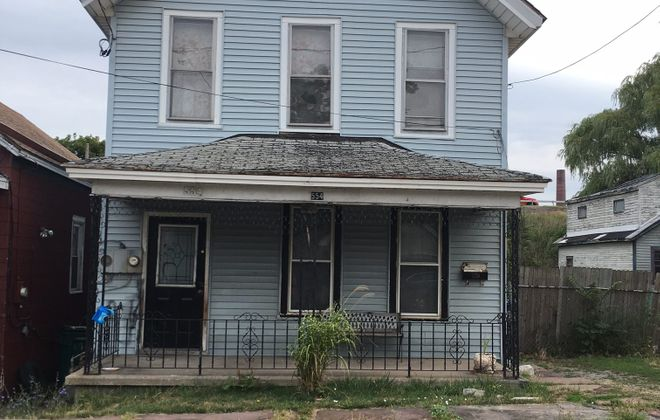 Neighbors say this Perry Street address is a drug house, that they want boarded up or demolished.