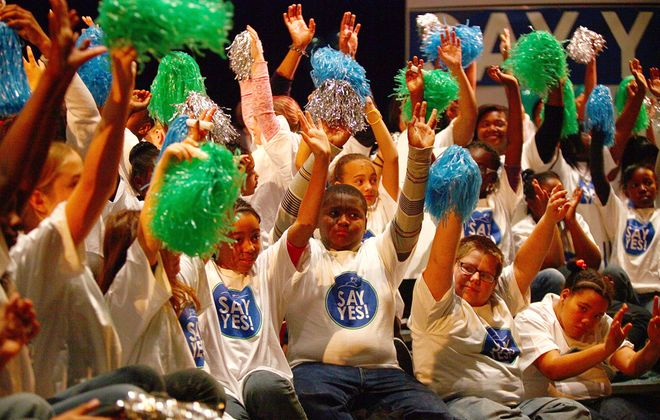 Students cheer at the original announcement of the Say Yes program at a rally at Buffalo Academy for Visual and Performing Arts in 2011. (Robert Kirkham/News file photo)