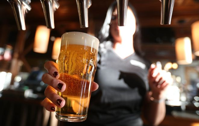 A bartender pours a beer from the tap at Ellicottville Brewing Company. (Sharon Cantillon/Buffalo News file photo)