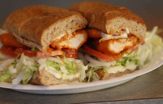 Eating a chicken finger sub from Jim's Steakout is something that every WNYer should do once.  (Sharon Cantillon/Buffalo News)