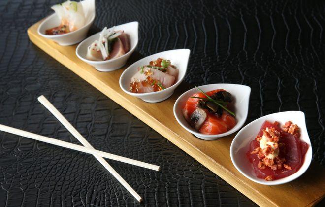 Fluke, left, albacore tuna, yellowtail, salmon and ahi tuna. (Sharon Cantillon/Buffalo News)