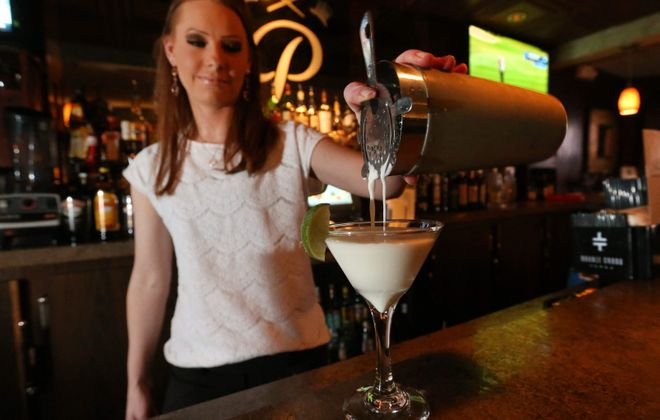 Bartender Jennifer Maulucci makes a key lime martini at Protocol Restaurant. (Sharon Cantillon/Buffalo News)