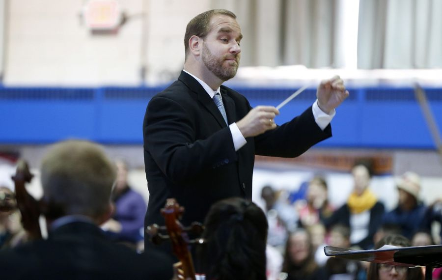 """Associate Conductor Stefan Sanders leads the Buffalo Philharmonic's """"Know the Score"""" concert on """"The Planets."""" (Mark Mulville/Buffalo News file photo)"""