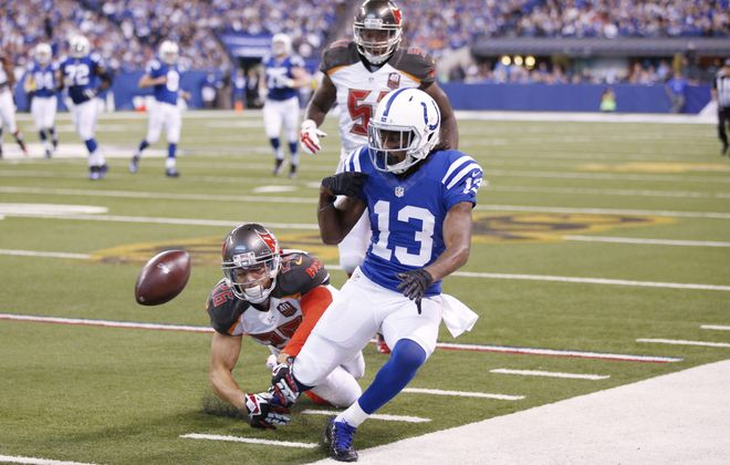 Sterling Moore (26) breaks up a pass for the Tampa Bay Buccaneers against T.Y. Hilton and the Indianapolis Colts last season.