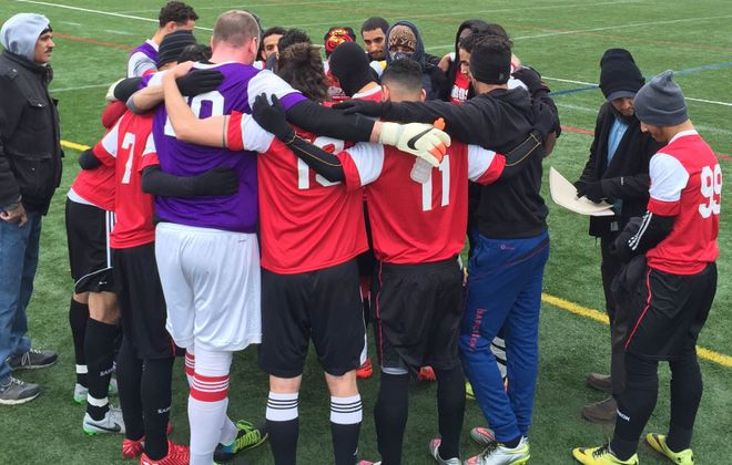 FC Yemen huddles up before their 3-0 loss to Christos FC. (Ben Tsujimoto/Buffalo News)