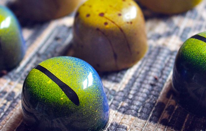 "Two Tanzanian-inspired chocolates, the ""Kashata"" (green) and ""Ndizi Kaanga"" (gold), are part of a fundraising effort to build a school for girls. (Photo Blue Table Chocolates)"