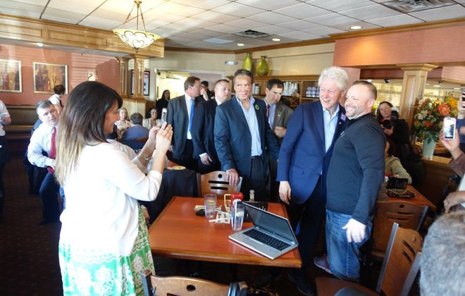 Former President Bill Clinton visits with patrons at Alton's restaurant in Cheektowaga early Monday afternoon. (John Hickey/Buffalo News)