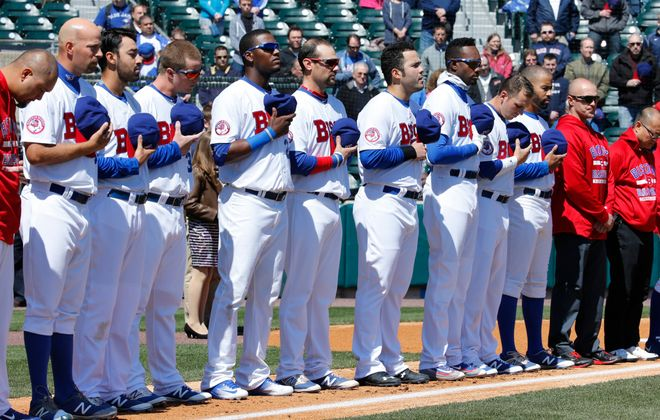 Buffalo Bisons players stand for the National Anthem prior to playing the Rochester Red Wings at Coca-Cola Field on Thursday, April 14, 2016. (Harry Scull Jr./Buffalo News)