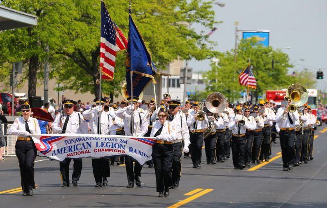 The American Legion Band of the Tonawandas Post 264 marches during the Memorial Day parade in Ken-Ton in 2015. It is one of several Memorial Day parades canceled due to Covid-19 concerns. (Mark Mulville/News file photo)
