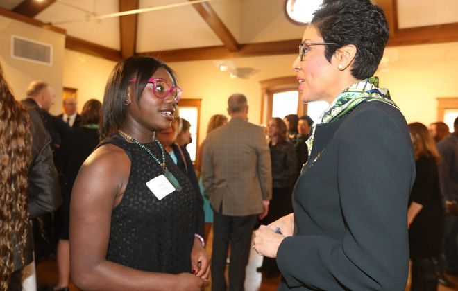 Zandra Cunningham, left, a Girl Scout and entrepreneur who sells her own line of personal care products, chats with Anna Maria Chavez, CEO of Girl Scouts of the USA, at a reception in Buffalo last week. Cunningham applies leadership lessons from scouting to her business. scouting.