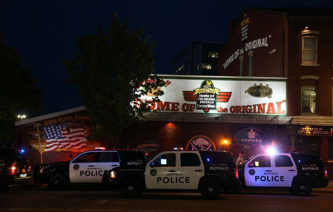 Police investigate a shooting that took place inside the Anchor Bar on Main Street in Buffalo on Friday, May 20, 2016. (James P. McCoy/ Buffalo News)