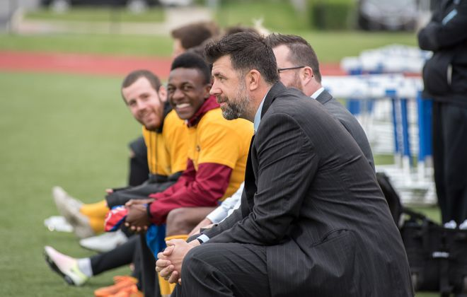 Brendan Murphy smiles on the bench before an FC Buffalo match in 2016. Murphy has been hired as the director of coaching for Delaware Soccer Club. (Matt Weinberg/Special to The News)