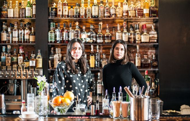 """Jessica Wegryzyn and Megan Lee, bartenders at Marble + Rye downtown, say women have moved past clichéd """"women's cocktails"""" like Cosmos. (Michael P. Majewski)"""