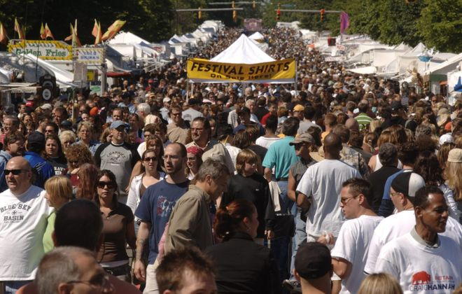 The Allentown Art Festival packs tens of thousands people onto Delaware Avenue and surrounding blocks. (Derek Gee/Buffalo News file photo)