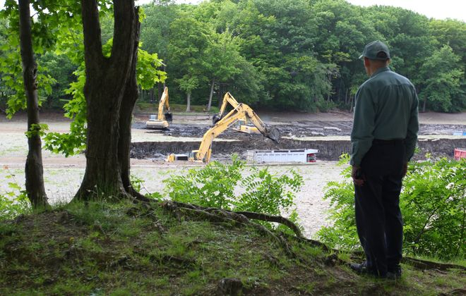 Peter Ehlinger of Orchard Park watches as crews use heavy equipment to dredge Green Lake in Orchard Park Monday, June 11, 2016.    (Mark Mulville/Buffalo News)