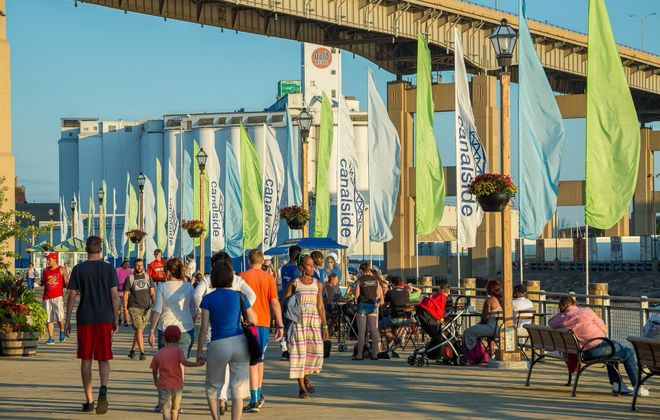 Buffalo's transformed waterfront park at Canalside was bustling with visitors Friday evening. (Don Nieman/Special to The News)