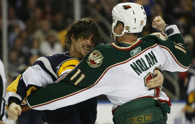 The Sabres' Steve Montador fights with Wild's Owen Nolan during a game in 2010 at HSBC Arena. Montador suffered 15 documented concussions and died at age 35. (Mark Mulville/Buffalo News)