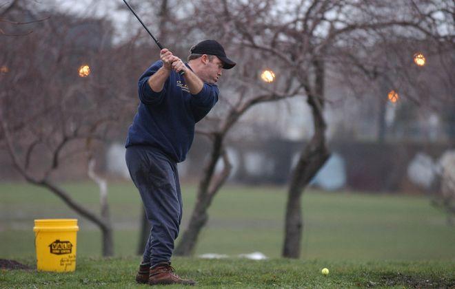 Golf on New Year's Eve in Buffalo: climate change? (Mark Mulville/Buffalo News)