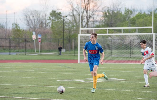 Ian McGrath, in blue, is the most recent former FC Buffalo player to sign a professional deal. (Matt Weinberg/Special To The News)