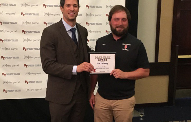 Tim Delaney poses with Steve Mesler after winning the Prep Talk 2016 Coach of the Year award. (Corey Desiderio/Buffalo News)
