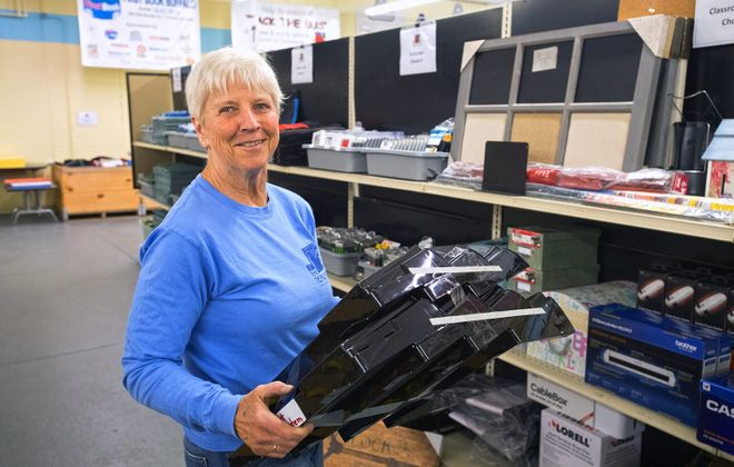 "Volunteers like Betty Pilato keep the Teacher's Desk, a local ""store"" for school supplies, on track. (Michael P. Majewski)"
