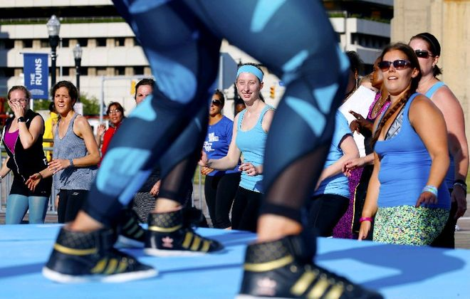 Canalside and BlueCross BlueShield of WNY will host one last Zumba class as part of an End of Summer Fitness Bash at 10 a.m. Sunday in the Canalside VIP Tent. (Robert Kirkham/Buffalo News file photo)