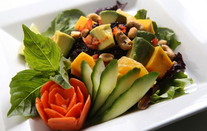 Sun Restaurant serves a black rice salad with avocado, mango, red pepper, spring mix, oranges, cashews, and house-made dressing.  (Sharon Cantillon/Buffalo News)