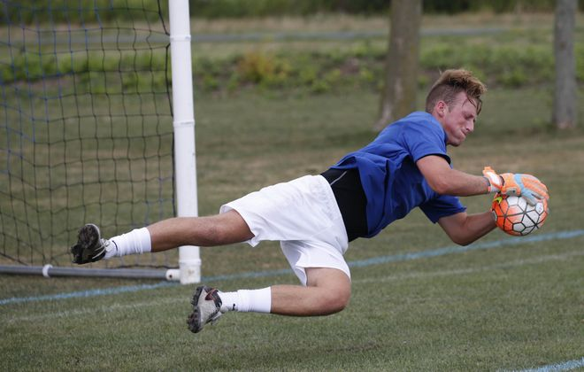 Goalie Justin Figler of Grand Island runs drills during practice with the Daemen College men's soccer team at the Northtown Center in Amherst, Tuesday, Aug. 16, 2016. (Derek Gee/Buffalo News)