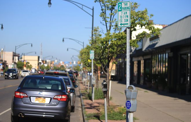 More parking meters will be placed on Hertel Avenue and paid meter parking hours will be extended. (John Hickey/Buffalo News)