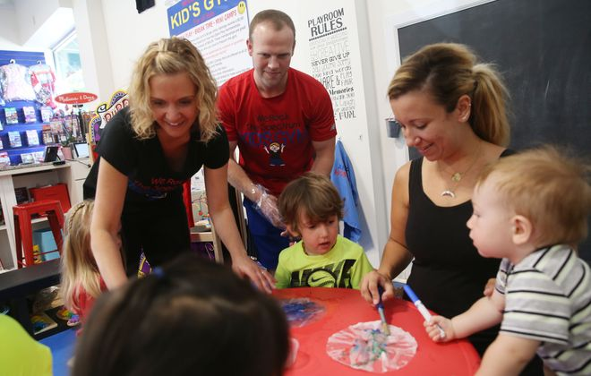 We Rock the Spectrum Buffalo Southtown Kids Gym at 6950 Erie Rd. in Derby is for children of all abilities and special needs.  Owners Jessica and Jeffrey Sills, left, help children make watercolor planets Tuesday, Aug. 9, 2016.  (Sharon Cantillon/Buffalo News)