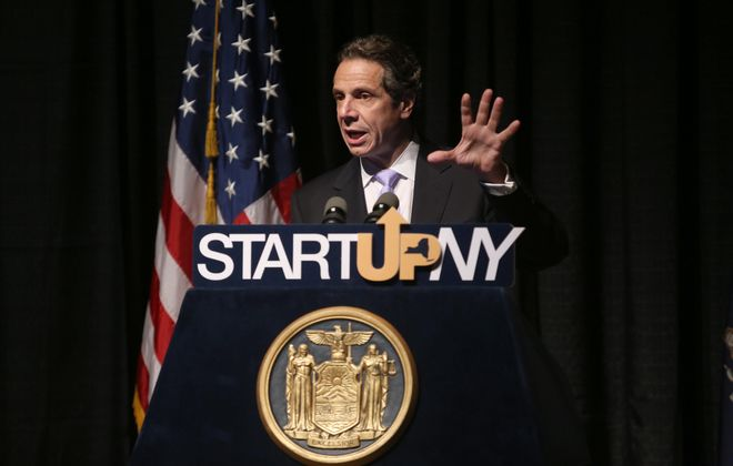 New York State Governor Andrew Cuomo talks about the Start Up NY economic development plan at a press conference at the Burchfield Penney Art Gallery on the Buffalo State College campus in Buffalo, Monday, June 24, 2013. (Charles Lewis/Buffalo News)