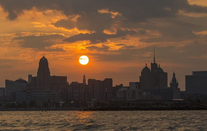 The sun rises behind the city skyline in summertime. (Derek Gee/News file photo)