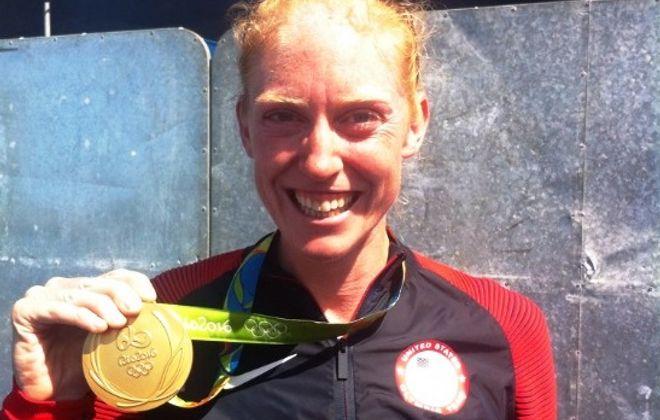 Emily Regan shows off her gold medal. (News file photo)