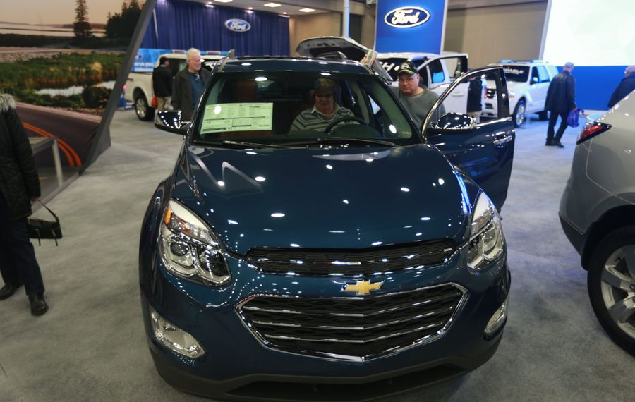 Chris Smith, left, and her husband Mike of North Tonawanda check out  a new Chevrolet Equinox  at the Buffalo Auto Show in Buffalo Niagara Convention Center in February. (John Hickey/Buffalo News)