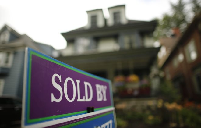 Area home sales cool off during hot month of July