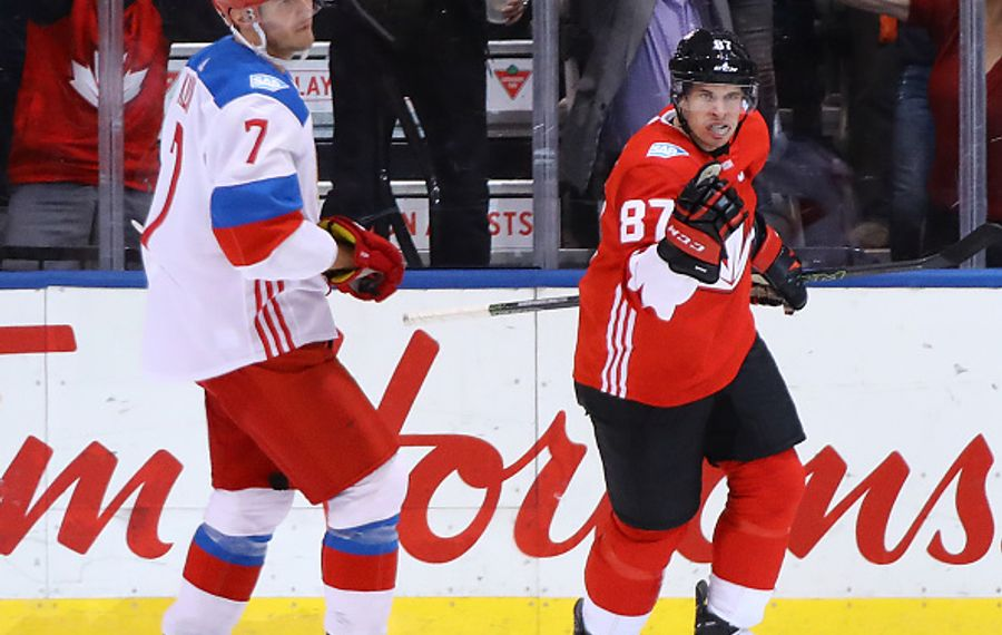 Sidney Crosby celebrates his first-period goal ahead of Team Russia (and Sabres) defenseman Dmitry Kulikov (Getty Images).
