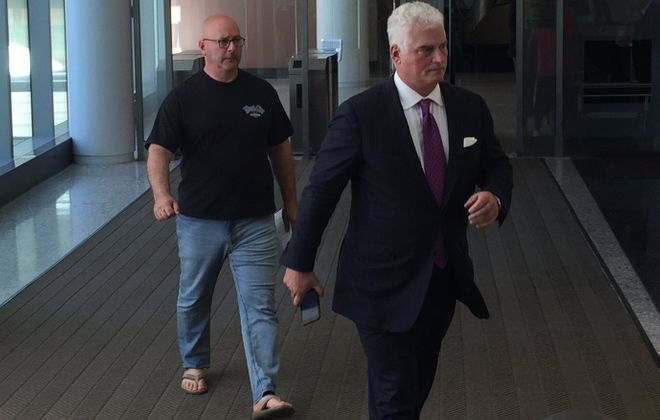 Louis Ciminelli leaving federal court with his lawyer in 2016. (Aaron Besecker/News file photo)