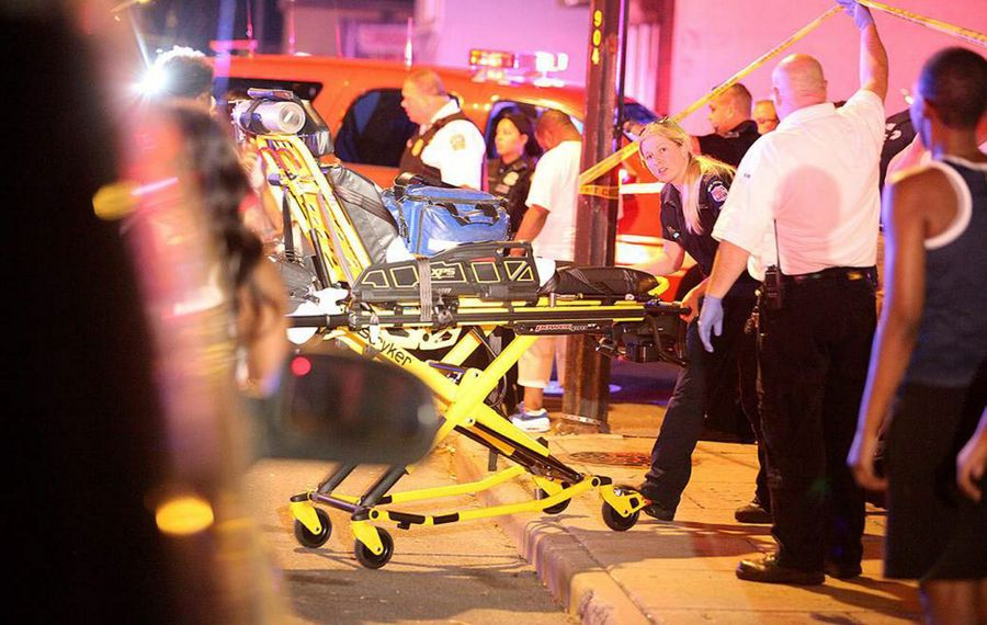 Buffalo Police tend to the scene of a double shooting on Strauss near Broadway early on a warm July 5. One man was pronounced dead at the scene. (Buffalo News file photo)