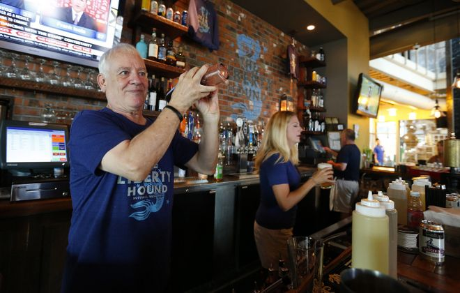 Marty Loesch mixes a drink at the Liberty Hound. (Mark Mulville/Buffalo News file photo)