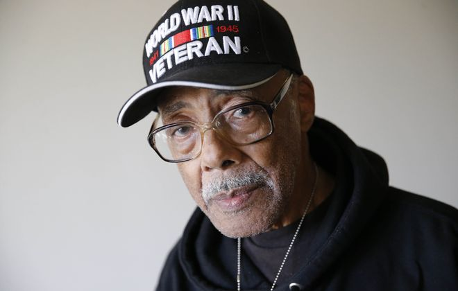 William J. Webb served in World War II and then reenlisted to serve in Korea. (Derek Gee/Buffalo News)