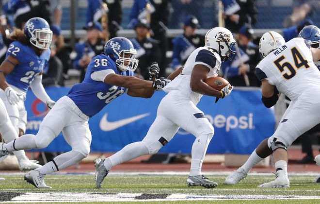 The UB defense has to cut down on the number of big running plays being unleashed by the opposition. (Harry Scull Jr./Buffalo News)