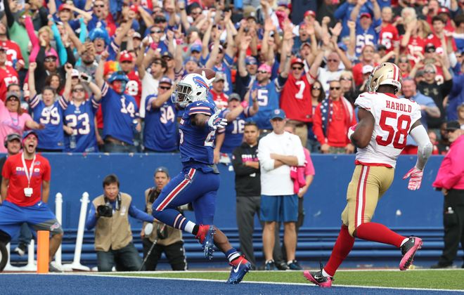 Buffalo Bills running back LeSean McCoy runs the ball into the end zone for a touchdown, his third of the game. (James P. McCoy/ Buffalo News)