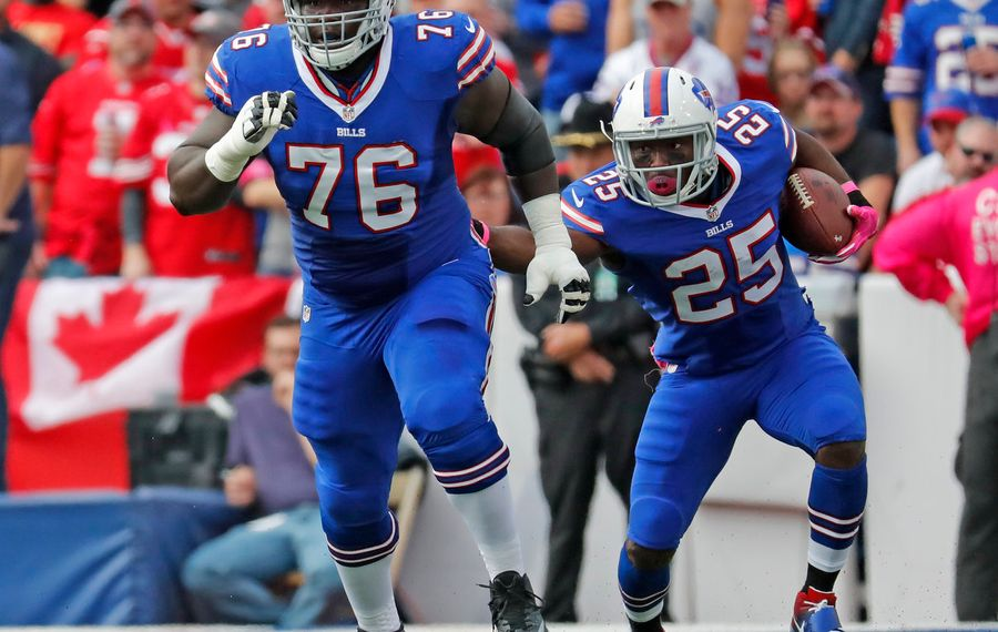 Buffalo Bills John Miller leads the way for LeSean McCoy (25) in the first quarter against the 49ers.(Harry Scull Jr./Buffalo News)