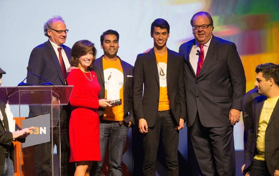 Oncolinx co-founders Sourav Sinha, CEO, left, and Riley Ennis, COO, pose for photos with Empire State Development CEO Howard Zemsky, Lt. Gov. Kathy Hochul and NYPA Chairman John Koelmel as they win the $1 million grand prize during the 43 North finals at Shea's Buffalo Theatre, Thursday, Oct. 27, 2016. (Derek Gee/Buffalo News)